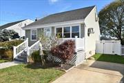 Well Maintained Charming Cape Updated Kitchen-2 Master Bedrooms-Upstairs Bedroom with Full Bath and Walk In Closet-Hardwood Floors-Updated Oil Burner/Siding and Roof-Front Porch-Close to Shopping and LIRR