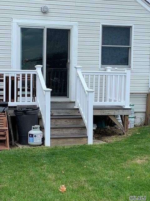 Waterfront unit with use of yard. Featuring Living room, EIK, Bedroom and full bath. Deck has been replaced.