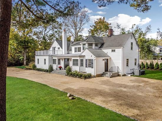 Set back off Split Rock Rd on a beautiful tree lined private acre is this newly renovated mini estate featuring a huge open layout Enter into a huge entertaining area featuring a custom kitchen with quartz counters, viking & sub zero appliances, bright & airy family room with fireplace, formal dining & living areas, cozy den with fireplace, guest suite with OSE, fireplace and Full bath, new hardwood floors throughout, Master suite with large closet, CAC, garage, IGS, 2 decks, a must see !