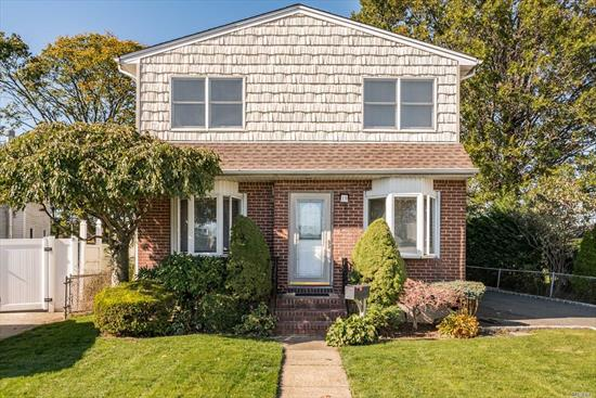 Beautiful Colonial in the Heart of Elmont! 3/4 BR's, 3 Full Baths, Updated Expanded EIK on 60x100 Property. Original DR was converted to Bedroom on the First Floor.