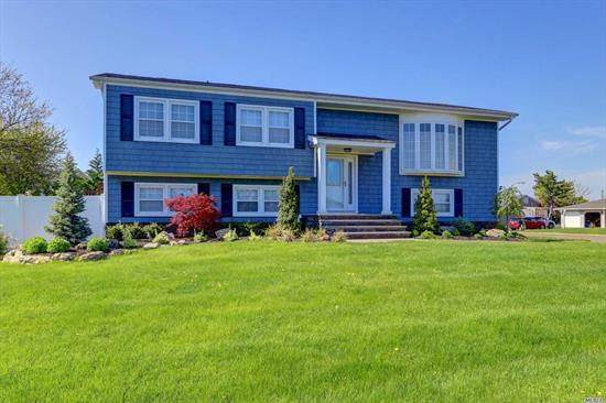 Oversized w/ fantastic curb appeal with beach & marina rights. Large rooms perfect for extended family or entertaining. Updated kitchen w/ deck that boasts water views. Master features full bath and walk in closet. Gorgeous Wood Floors, Family Room with fireplace and sliders out to beautiful paver patio. Also features CAC, IGS & high efficiency boiler! MOTIVATED SELLERS and Taxes being grieved.