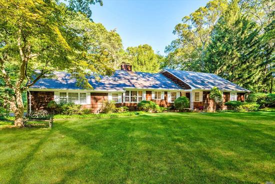 Nestled at the end of a Cul-De-Sac, this Farm Ranch in desirable Muttontown set on 2 usable flat acres awaits you. A large EIK w/Fpl leads to a warm and inviting open floor plan D/R, L/R, Den/Fpl, all with hard wood floors. Two bedrooms on each floor allows for many options. Linden Lane is off Northern Blvd and gives easy access to LIRR, Major Roadways, Shopping, and more. Incredibly low taxes cannot be beat!