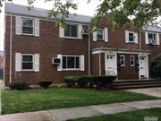 Large 2BR G, Main floor full corner, Open concept layout, Mica kitchen, Remodeled bath, Steps to buses.