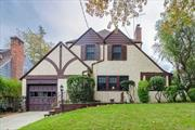 A most charming well kept Tudor home in Historic Douglas Manor. A waterfront community with boating and swimming within walking distance. The home has a living room with a fireplace, a cozy den, a formal dining room opening out to a private blue stone porch and a lush garden. Great covered entry from the garage to an eat in kitchen. Fifteen minutes to LIRR 28 min to NYC A commuter's dream