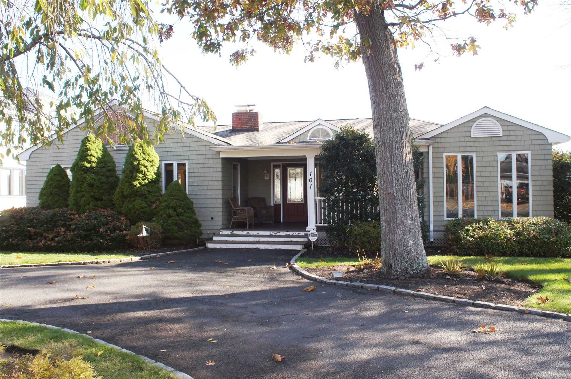 Incredible waterfront ranch in the Holiday Beach section of Center Moriches. 75 ft of bulkhead with dockspace for 4 boats. 40' x 6' floating dock w/water and 30 & 50 amp service. 2br, bth, mb w/bth, kit w/fp, dr w/fp, lr and pfin bas. exquisite views from lr & mst br. Step out onto the deck overlooking the water to an amazing semi ig pool. Perfect for entertaining! A must see. Call today.