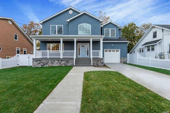 Magnificent Brand New Colonial w/2 Story Grand Entry, Rocking Chair Front Porch, Master Suite w/huge Closet & Bath, Custom Kitchen w/high-end SS Appliances, Lg Family Rm w Fireplace, Close to Schools (SD #7) LIRR, Shopping & Dining
