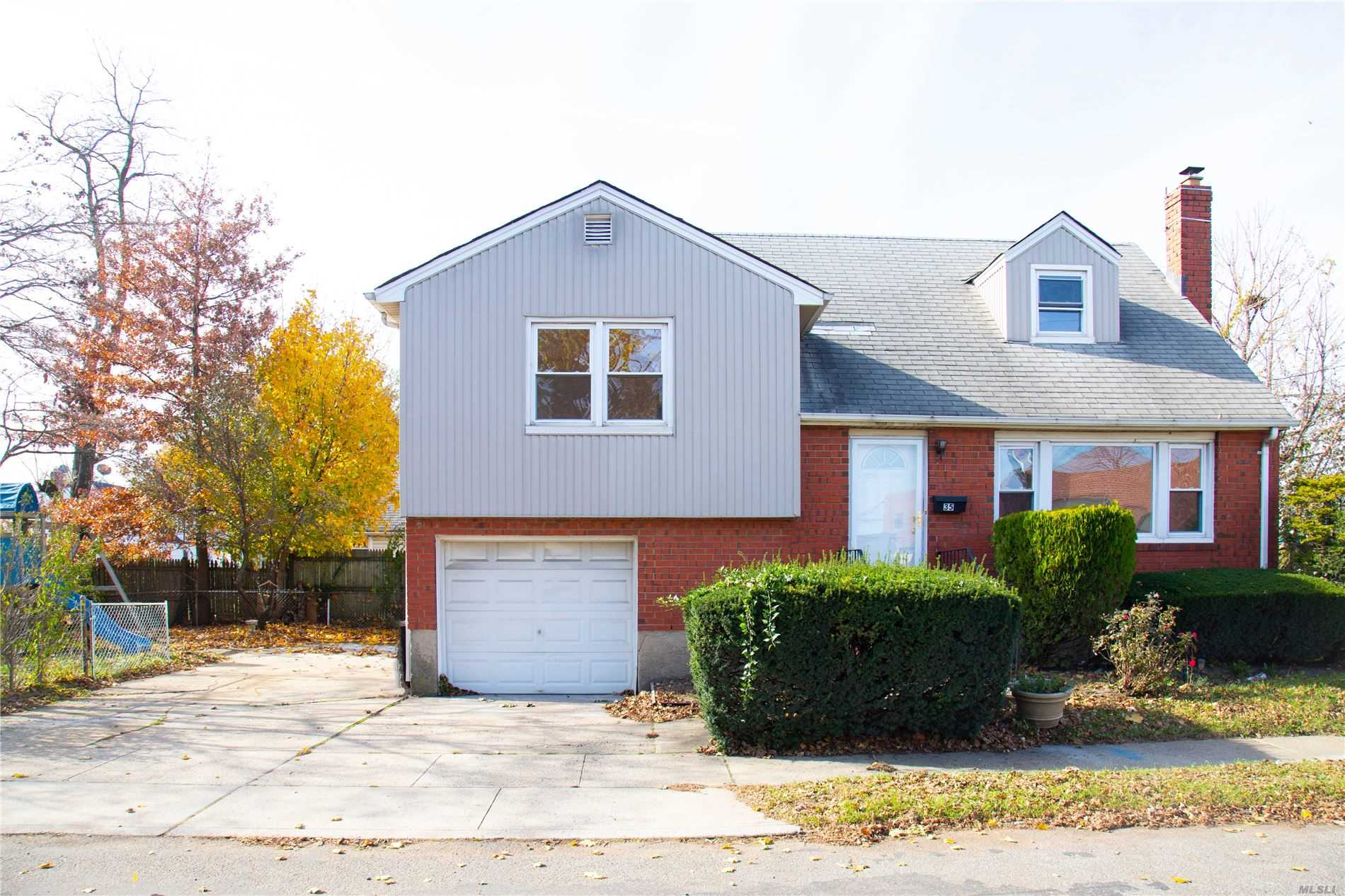Welcome To This Move-in Ready Charming Split. Almost New, Totally Renovated, Bright, Spacious, Open Floor Plan, Attached garage, Lot Of Storage, Possible Use as Mother-Daughter With Permits. Convenient location, Close to transportation and shopping!! Close to LIRR. Come See It Today Before It's Gone!!