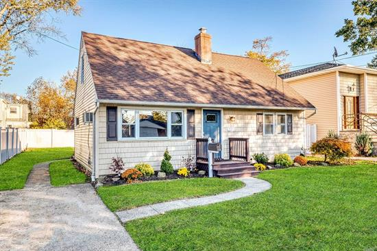 Amazing opportunity to own this 4 bedroom cape located in the Mandalay section of Wantagh. Located mid block and in the Wantagh #23 school district. Brand new designer kitchen with quartz counters and Frigidaire professional series appliances,  refreshed bathroom, refinished hardwood floors, updated roof, siding & windows, trendy reclaimed wood wall, massive party deck & large back yard. Just beautiful is the way to describe this charming home. Unpack relax and enjoy the holidays!