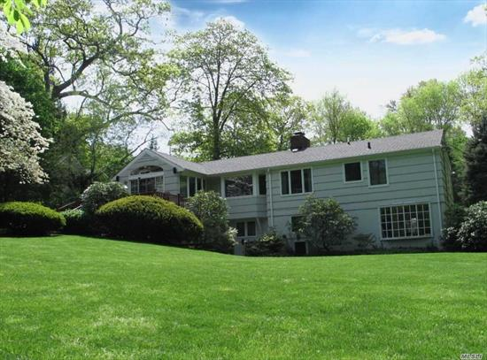 Sun-filled Farm Ranch on a usable 1/2 acre at the end of a cul-de-sac in the desirable Midland Section of Cold Spring Harbor. Hardwood floors, master en-suite w/ walk-in closet, first floor laundry, wood burning fireplace, plus much more! Eat-in kitchen adjoins family room w/ vaulted ceiling & glass sliders to deck. Walk-out lower level w/ recreation room. Backyard w/ mature trees, gardens & room for a pool. Situated only minutes to village, train & Eagle Dock Beach w/ mooring rights (fee).