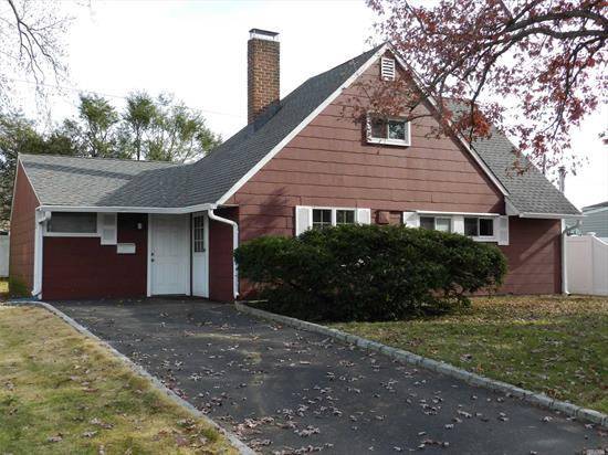 Great Location, Living Room With Fireplace,  Updated Roof & Windows. Newer Heating System. Private Yard,  Needs Updates.