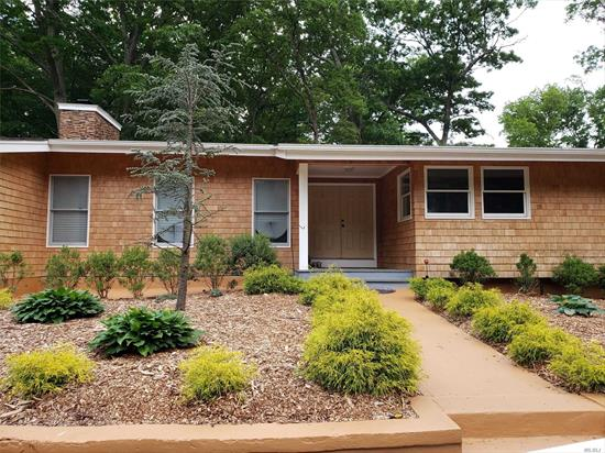 Put The Welcome Mat Out. This Spacious Ranch With Large Entry Foyer and Open Floor Plan is so inviting. Gorgeous Living Room With Stone Fireplace, Formal Dining Room With Sliders Out To Covered Porch With Outside Fireplace, Eat In Kitchen With Granite And Stainless Steel Appliances Master Suite With Full Bath, 5 Additional Bedrooms, Family Room, Along With 2 Full Baths. Gleaming Hardwood Floors And Tile Throughout. Room For Extended Family A Must See