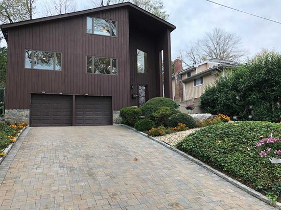 Modern and bright, this spacious home in Manhasset Bay Estates is comfortable and built for easy living. Lovely eat-in- kitchen flows to living room with fireplace and cathedral ceilings. Potential for master on the main, 3 beds 3.5 baths. Plus Family Room or Office. Every bedroom has an en-suite bathroom. Almost 2900 square feet of living space on a lovely block. Beach rights with dues. A must see! Central A/C & Gas Heat.