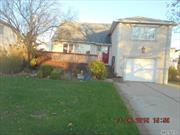 3 br 3 bath split level home in the heart of Island Park. Large sunny den, fully fenced yard. Excellent schools