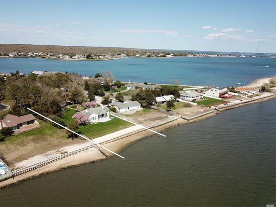 Amazing Property .84 acre Directly On Shinnecock Bay with your own private beach and mooring rights.Forever views of Bay to Barrier Island. Storage shed w/ dressing room and cedar closet.4 bedrooms including Master Suite plus 3 additional bedrooms and 2 full baths.Living room/EIK w/fireplace and skylights. This hidden gem has not been For Sale for nearly since 1972 - Awaiting your personal touch.