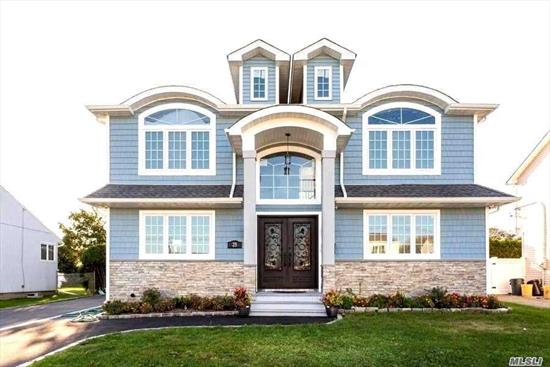 Come check out this masterpiece newly constructed colonial in North Hicksville. This house sits on a mid-block location and has large 5 bedrooms & 4 full baths. Chef's eat in kitchen w/SS appliances & granite counters & custom cabinets.Two master bedrooms one each floor for added comfort. Formal dining room, office, full bsmt w/OSE. High ceilings w/high-hats all over. Hardwood floors, central AC, gas heat. Large fenced backyard. 1-space att garage. Make this your next home...