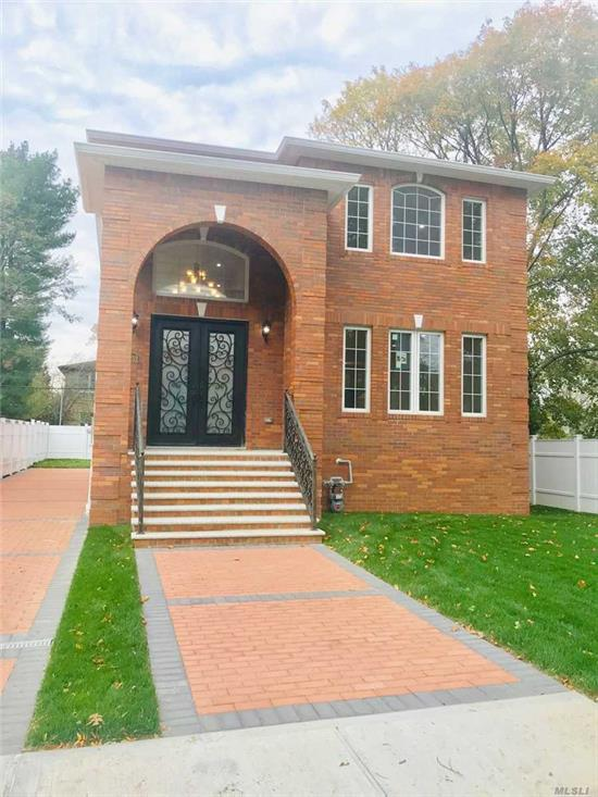 Spectacular Brand-New large brick colonial in very convenient neighborhood. Cathedral grand foyer. Custom-made spiral staircase. Marble Center-Island gourmet kitchen. Central vacuum system. Spacious master bedroom suite. Mother's bedroom on 1st floor. 2nd foor laundry room. Enclosed large back patio 4000 sq ft living space. Easy to commute. Near Bayside LIRR and Northern Blvd bus stops and shops. School district #26.