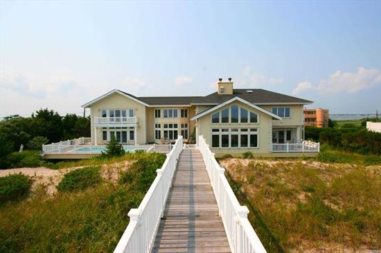 Waterfront Luxury! Sprawling oceanfront home on prestigious Dune Road. Sun-filled and spacious w/1st and 2nd Floor master suites. This home has an open floor plan with chef's kitchen, top of the line appliances, large dining room, over-sized living room w/fireplace, 2nd floor den w/fireplace and 3 addl. en-suite guest bedrooms. Generous Mahogany decking surrounds heated gunite pool with spa. A private walkway to the ocean complete this resort-like setting!