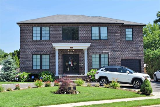 Magnificent 4 bedroom 2.5 bath colonial. Beautiful mid. block locale. Award winning Carle Place schools