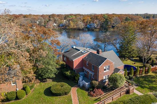 This spacious waterfront village home sits on 0.58 acre mid-block on the Great Patchogue Lake. Well-maintained w/ stunning views, this stately brick home features quality craftsmanship, custom hardwood floors throughout, 1st floor bedrm w/ ensuite full bathroom, ss appliances, a full finished basement w/ 1/2 bath, a huge master bedrm suite, and is much larger than it seems, boasting a total of 4 bedrms and 4.5 baths, including a legal accessory apartment over the detached 2-car garage.