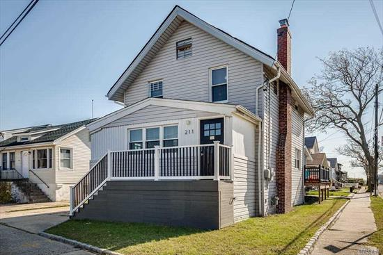 Move right in to this completely renovated 4 bedroom, 2.5 bath home with beautiful new kitchen and baths, rights to private beach, quiet block.