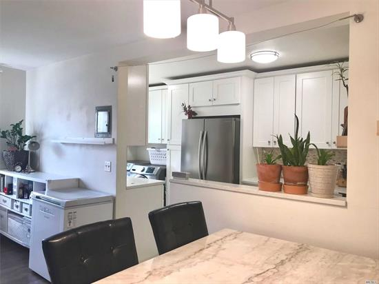 Totally renovated, Bright, Open Kitchen, Stainless steel appliances, washer and dryer in unit, hardwood floors, first floor. Easy to show. Maintenance includes, heat, Electric, Gas, Water.