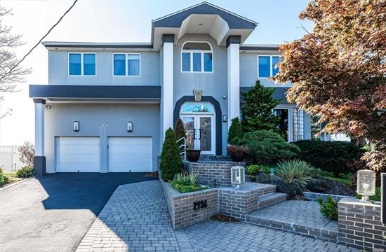 Open Bay 'Lindenmere' Custom Colonial On 1/4 Acre Of Cul-De-Sac Property! Huge Full Finished Basement! Large Marble Eik W/Walls Of Glass Looking Out To The Bay! Approx.4 Yr.--185' Of Vinyl Bulkheading!! High Elevation W/2Yr. New Granite Bbq W/Frig. 3 Brand New Compressrs, Andersens Thruout! Beautiful Layout W/Panoramic Views! All Information Deemed Reliable But Not Guaranteed. Waterfront Oasis W/ Floating Dock, Boat Lift, Jet Ski Dock, New Bulkhead, outdoor kitchen,