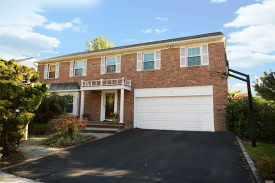 owner would consider a short term rental too.....Recently Renovated Young Brick Front Colonial On A Quiet Street In North Syosset. This Home Has A New Kitchen, Windows, Roof & Siding! Stainless Steel Appliances, Laundry Off Kitchen, Large Den With Slider To Decking, Finished Basement, Gas Heat & Cooking! Truly A Gem.