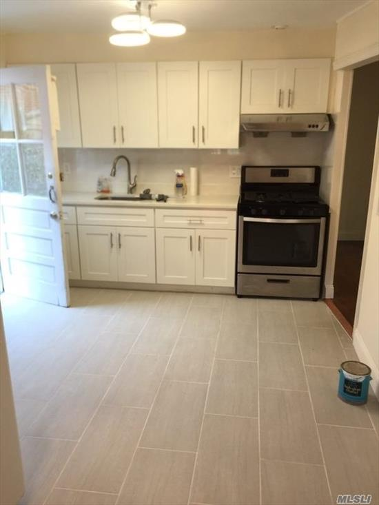 Newly renovated 2 br apartment on 1st Floor with brand new hardwood floor. Access to back yard. Across the street from school. Close to shopping center, Major freeways. Easy street Parking.
