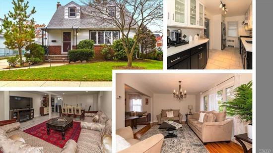 This expanded cape shows like a Dutch Colonial, featuring 4 B/R 2 Bath. this home is a true turn-key from its open concept Kitchen and Dining Room to the new baths, Finished basement, 2 car garage and parking for 4 more cars. Unobstructed views, new gas boiler, and hot water heater. Don't wait it won't last long! Mins from shopping and LIRR