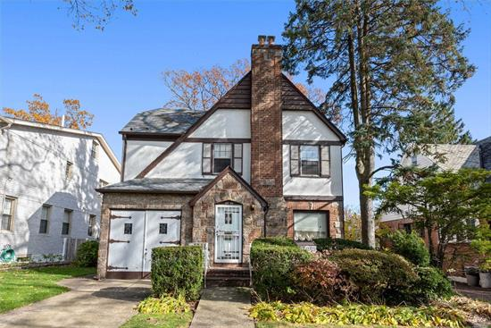 Magnificent and Charming Brick Tudor in the Heart of Jamaica Estates. This Classical Property with its Elegant Architectural Detail Introduces a Large Foyer, Spacious Formal Dining Room Able to Accommodate 20 Guests, Beautiful Living Room, Eat-in-Kitchen, Half Bath and Magnificent Huge Family Room with 5 Sky Lights Adorned by a Plethora of Large Windows which is Adjacent to the Kitchen and Dining Room. The Upstairs Introduces 3 Huge Bedrooms and Full Bath with a Separate Shower Stall. Must See!!