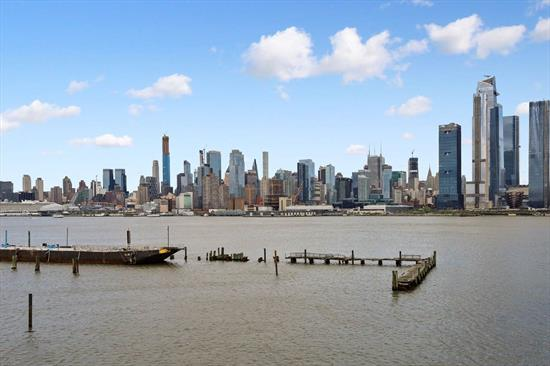 Enjoy breathtaking views of NYC and The Hudson River from this delightful waterfront condo! Some of the choice features of this inviting unit include granite counters, stainless steel appliances, wood burning fireplace, private balcony, and washer/dryer in unit. This fantastic waterfront community provides 24 Hr Concierge, State-of-the-Art Gym, Indoor Pool, Yoga Room, and garage parking for one car. Super easy commute to NYC via Ferry next door, Light Rail or Bus! The perfect place to call home!