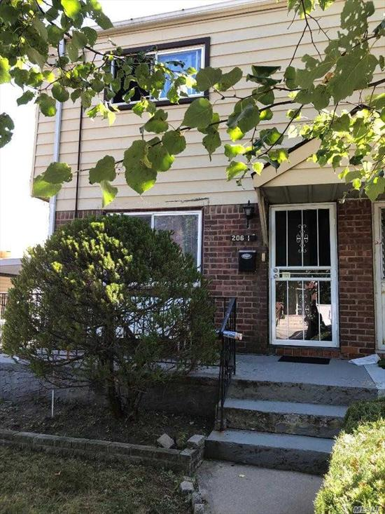 Semi Attached Colonial In The Heart Of Bayside. House Has Nice Size Room - Enclosed Yard - Needs TLC - Near Bus, Highways & Stores.