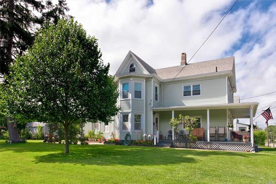 Classic Village Farmhouse, currently a 2-Family. 4 bed, 2 bath. Heart of West Dublin. Short Blocks to Downtown, Bay Beach, Transportation. Low Taxes.