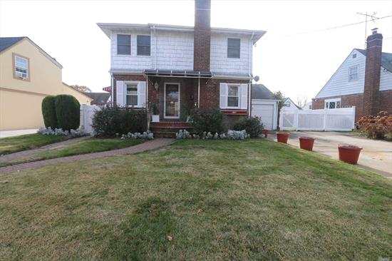 Magnificently Well Kept 5 Bedrms, 3 Baths With Full Finished Basement Colonial Comes Wth Many Recent Updates From Bathrms To Paved Backyard. 1st Fl Features Kitchen, Bath, Living-Rm, Large Dining-Rm And 1 Bedrm. 2nd Fl Features Master Bedrm & 3 Good Size Bedrms & Recently Remodeled Bath. Basement Has Large Living Area A Bath & OSE. Ideal Location! Close To House Of Worships, Hwys, Shopping & Public Trans. Possible Mother/Daughter With Proper Permits. LOW LOW TAXES. Must See!