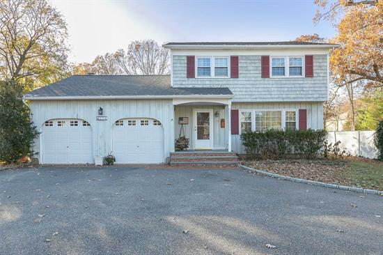Welcoming Custom Built Colonial on Half Acre. Builder was Glenn Hill Estates. Spacious Principal Rooms, Den with Wood Burning Fireplace, Wood Floors Throughout, New Roof, New Windows, 2 Car Garage. Flat and Usable Half Acre is Ideal for Quiet Family Gatherings or Gracious Entertaining.