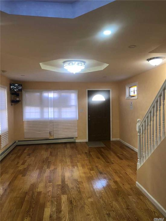 Finished In Exquisite Condition, New Baths, New Kitchens With Quartz counter top, New Appliances, Wood Floors New Walls, Design Ceilings, Security Cameras System.Light Fixture, Full Finished Basement, New Sidings, New Boilers, Hot Water Tank, New Window