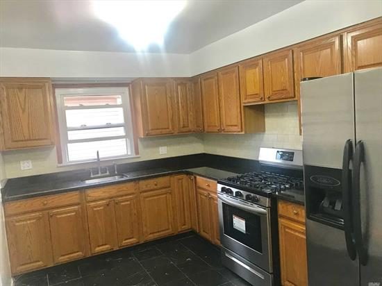 Spacious 3 bedroom, Freshly painted new kitchen and bath. Hardwood floors Private two family home. Near all transportation and hospitals. Port washington Line.