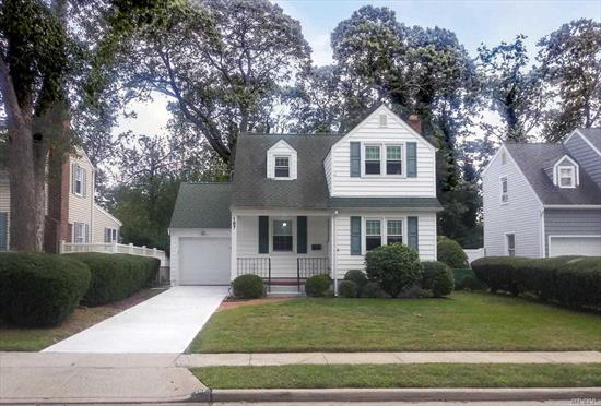 This beautifully maintained traditional home on a small dead-end street in Merrick Oaks is in move-in condition. Roof, doors, windows, & siding have all been upgraded, floors are red oak hardwood. Only a short distance from the Merrick LIRR station this property includes fenced back yard, backed by lush green state-owned land. With formal DR, large family rm & LR w/fireplace this 3 BR, 1.5 bath house features generous closet and storage space. See detail section for complete list of appointments