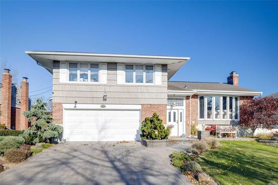 Large Mint Split Style home with an extra 5th level, 4 BR, 3 Full Bth, Eik, LR-DR, Hardwood Flrs, NEW CAC 2 Zone Gas Heat, 2 year old Boiler and H20 Htr, French Drain (Bocci), Updated alrm system, Heated Floors in Mastr Bth with Correra Marble, Roof on first level, Peacock granite in Kitchen, Den and laundry Rm ripped to studs last year and was completely updated and insulated, Custom bar with wine cooler, swan cabinets, Porcelain tile, Ing gunite pool 20x 40, New Pavers, Quiet block, LOCATION!!!