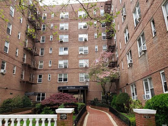 Awesome opportunity in a secure and elegant doorman building. Spacious Jnr.1 has a flexible space plan. Separate kitchen, dining foyer, large living room & bedroom. Newer stainless appliances and AC. Great wood floors beneath carpet.This corner unit is on a high floor permitting superior ambient light and cross ventilation. There are 4 large closets and a full sized kitchen with a window. Conveniently located close to public transportation, parks and wonderful shops and restaurants.