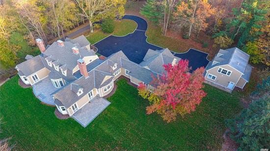Estately brand new construction. Quality craftmanship completely finished 2019. Welcoming floor plan with open flow. Multiple French Doors offering an abundance of natural light. Enjoy the Master Suite with fireplace conveniently located on main floor. Extensive details throughout with elaborate moldings, coffered ceilings, marble kitchen and gleaming wood floors. Additional 2 car garage with upstairs loft space. Sequestered in exclusive Cove Neck private location with a water view.