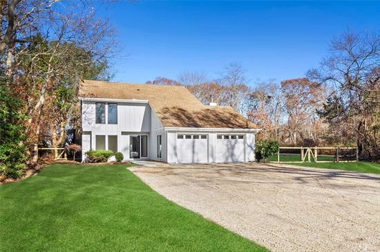 Just completed update and renovation at this incredible residence sited south of the highway in Westhampton. A beautiful, pristine and desirable contemporary style home with 4 bedrooms and 3 full bathrooms privately nestled on a cul-de-sac on a 1.25 acre property. The spacious living room, dining room and kitchen layout opens out to the in-ground pool (with new liner) and spacious grounds. The kitchen is equipped with brand new, fine cabinetry, Quartz countertops, and stainless steel appliances.