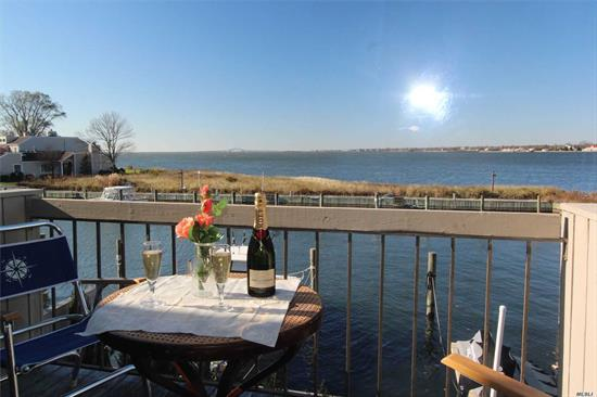 Bay Front. 2 Story, in The Club w/ Boat directly behind your home.Enjoy Breathtaking Sunsets over the Great South Bay with the Captree Bridge as your back drop!. Just minutes to Fire Island and Fabulous Restaurants. Grounds Pristinely maintained with Tennis Courts, Heated IGP, Old Estate Club House w/ Billards, FirePlace, Piano Antique Bowling Alley & Squash Quart. Spacious Condo H/W.Floors, All redone, Fresh Paint, Wood Burning Stove, As Good As it Gets!! Sun and Fun!