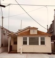 Waterfront- new electric, kitchen cabinets, tiled bathroom, new heating system, back deck, walk to parks, tennis courts, Gateway National Park, express bus to Manhattan, Rockaway Ferry, 20 mins to JFK.