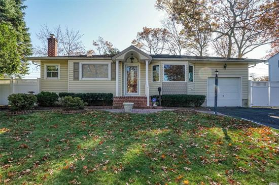 Expanded Ranch in Hauppauge Schools featuring 3 Bedrooms, 2 Full Baths. Hardwood Floors, Central Air, Sunroom, Living Rm w/ Gas Fireplace, Dining Room w/ French Door Sliders overlooking South Facing Sunroom, Master Bed w/Vaulted Ceiling & Double Closets. High Hats Throughout, 4 Skylights, Newer Siding, Roof, Windows, Hot Water Heater & Front Portico. Paver Walkway. Slate/Paver Front Steps, Fenced Yard, Patio, 1 Car Garage, Attic Pull Down Ladder, Inground Sprinklers, Side Walks
