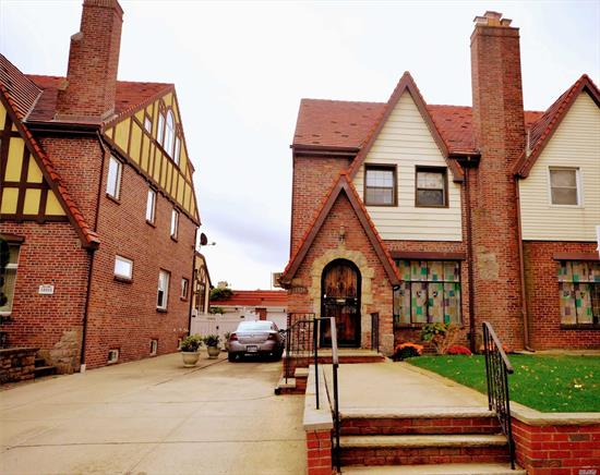 Beautiful All Brick Tudor House in a quiet block. 4 Br, 2.5 Bath. Eat In Kitchen With Entrance To Back Yard from the 1st fl and basement. Fully Finished Basement. 1 det car garage with private driveway. Convenient Location, Near Highway, Buses, Shopping, schools And Restaurants. House is Being Sold AS-IS, Needs a Bit of Work.