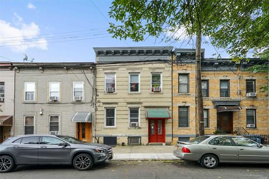 2 family in the heart of Ridgewood with private yard located approx. 4.5 blocks to Forest Ave M train