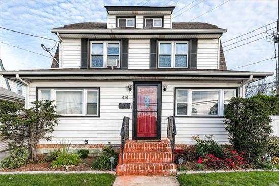 Beautifully Maintained 4 bedroom, 2 Bath home in Malverne. First floor hosts an Open Modern Concept . Hardwood floors, Stainless Steel Appliances, Updated Kitchen,  1st Floor Den or Office. Full Finished Basement,  Full Finished Attic. 4/10 of a mile to the Malverne Train Station.  Turn Key Home! Move In Ready!