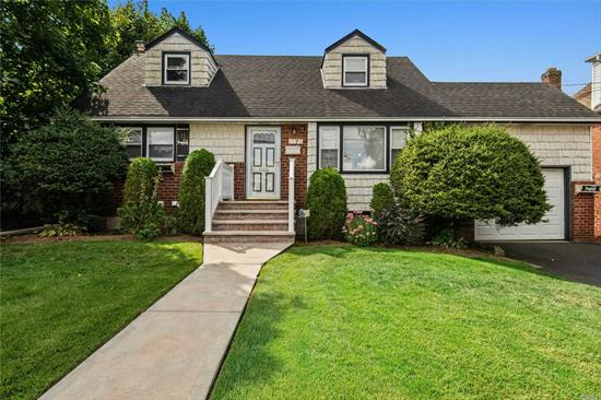 Very Well kept 4 Bedroom Cape, Beautiful Block, Living Room, Dining Room, Eat in Kitchen, Full Bathrrom, Master bedroom, Bedroom, Upstairs 2 Bedrooms, Full finished basement with outside entrance, Gas Cooking, Attached Garage, In-Ground Sprinklers. Close to Transportation and Shopping