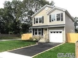 New construction, 4 bedroom, 2.5 bath colonial home. Spacious living room, dining room, eat in kitchen with all wood cabinets, stone countertops, stainless steel appliances. Wood floors throughout main level. Many green features include heating system, central air windows and appliances.